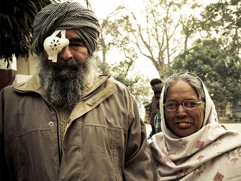 Nepali husband with eye patch and his wife wearing glasses