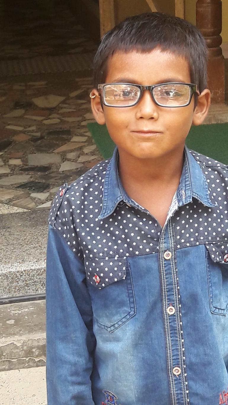 Guddu wearing his new glasses