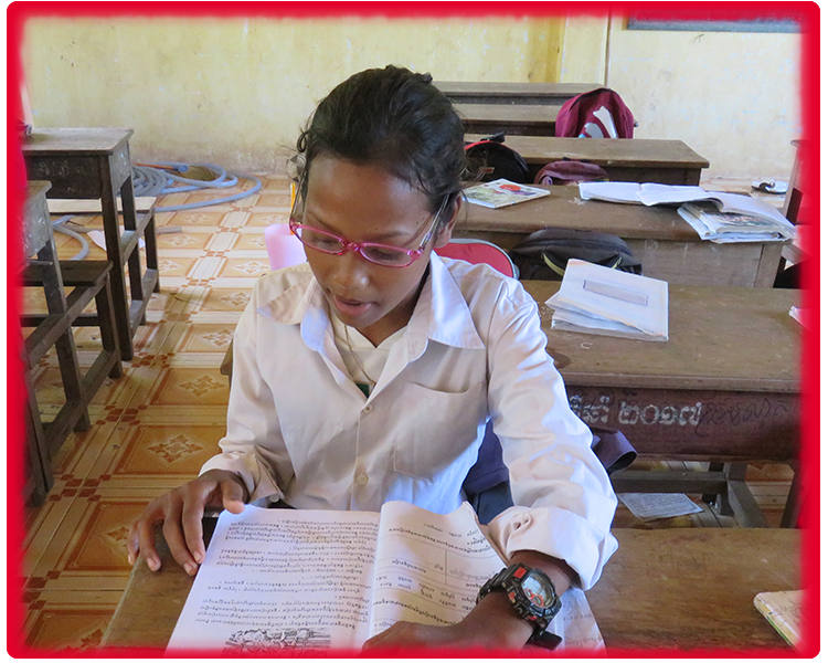 Thuon Cambodian girl with glasses studying