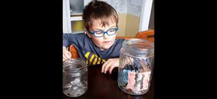 Zachary explaining his donation jar for Seva Canada