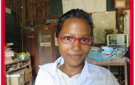 Thuon Cambodian girl with glasses and red border rounded