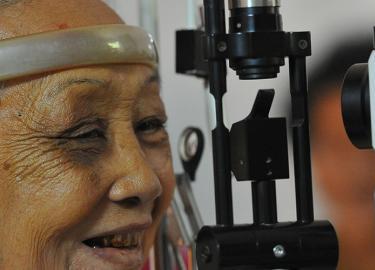 Cambodian woman having eyes examined