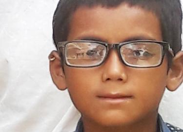 Guddu wearing his new glasses