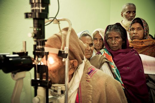 Nepal eye care patients lined up for eye exam